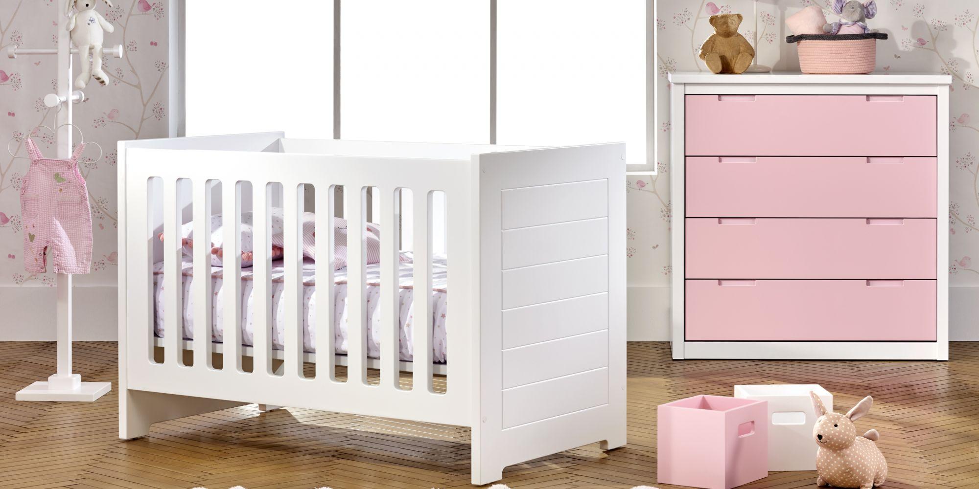 Cuna para bebé y cómoda con 4 amplios cajones color rosa para almacenaje
